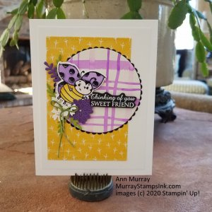 Purple ladybug in flowers with water color plaid background.