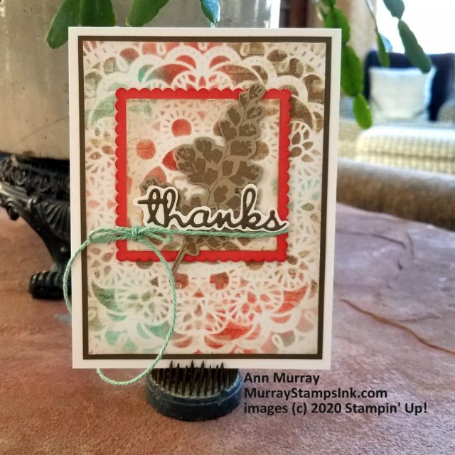Stencil background with shimmery embossing and an eclipse focal image