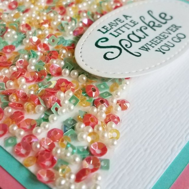 Close up of sequins on card