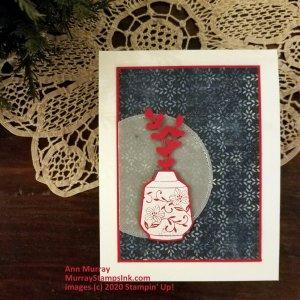 white embossed red vase on blue patterned background