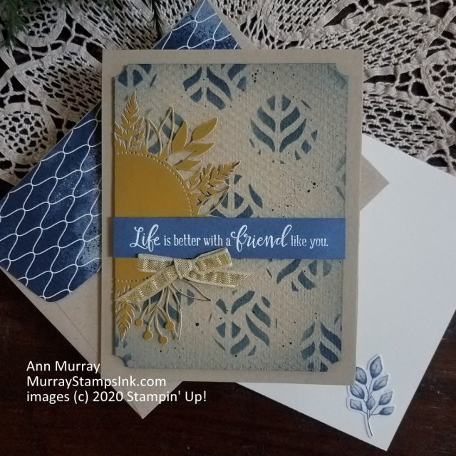 textured and stenciled card with gold laser-cut fern circle