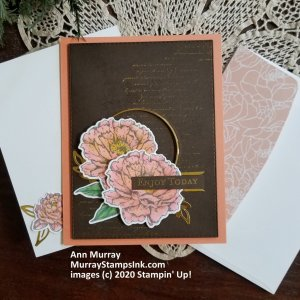 layering peonies on gold script background